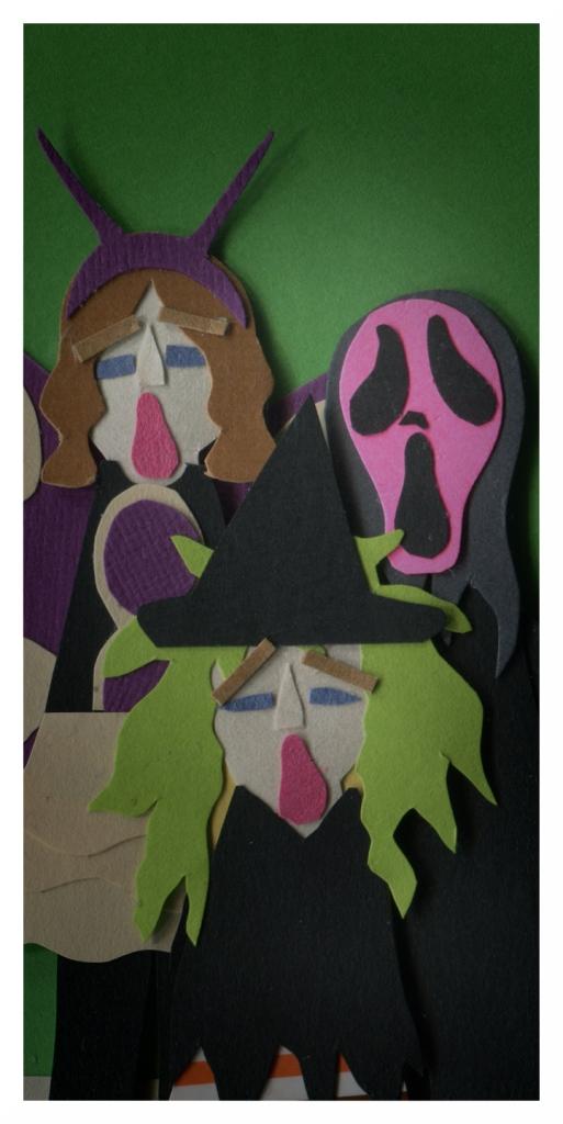 The girls look shocked, imitating Ashley's Scream mask.