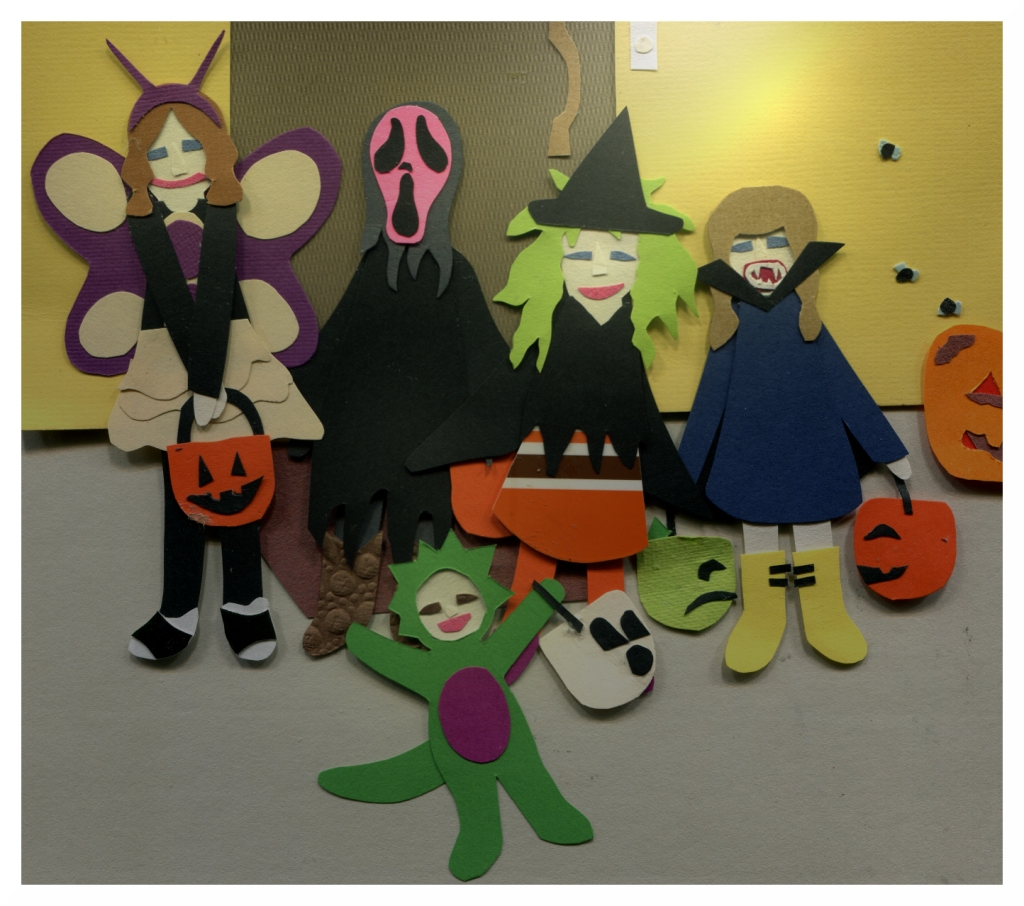 The girls are in their costumes, ready to trick-or-treat.